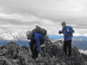 Brad and Nick scrambling over Tricouni Peak.