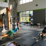 SkinTrack Training Camp attendees doing core strength during a session at Challenge By Choice