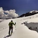 Nick skinning between slots on the Roosevelt Glacier.