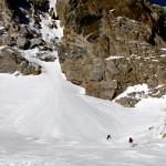Regan and Davey skiing below the Grand