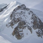 Mont Blanc du Tacul with the prominent Triangle du Tacul facing the Aig d Midi. The Contamine-Mazaud travel up the centre couloir/snowfield. The Goulotte Chere is just out of view on the right.