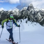 Nick skinning above the Gondola with Mt. Habrich in the background.