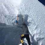 Colin climbing through the final shrund/crevasse on Lib Ridge.